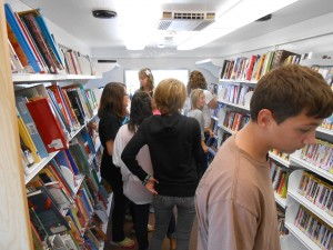 High school students explore the bookmobile's offerings