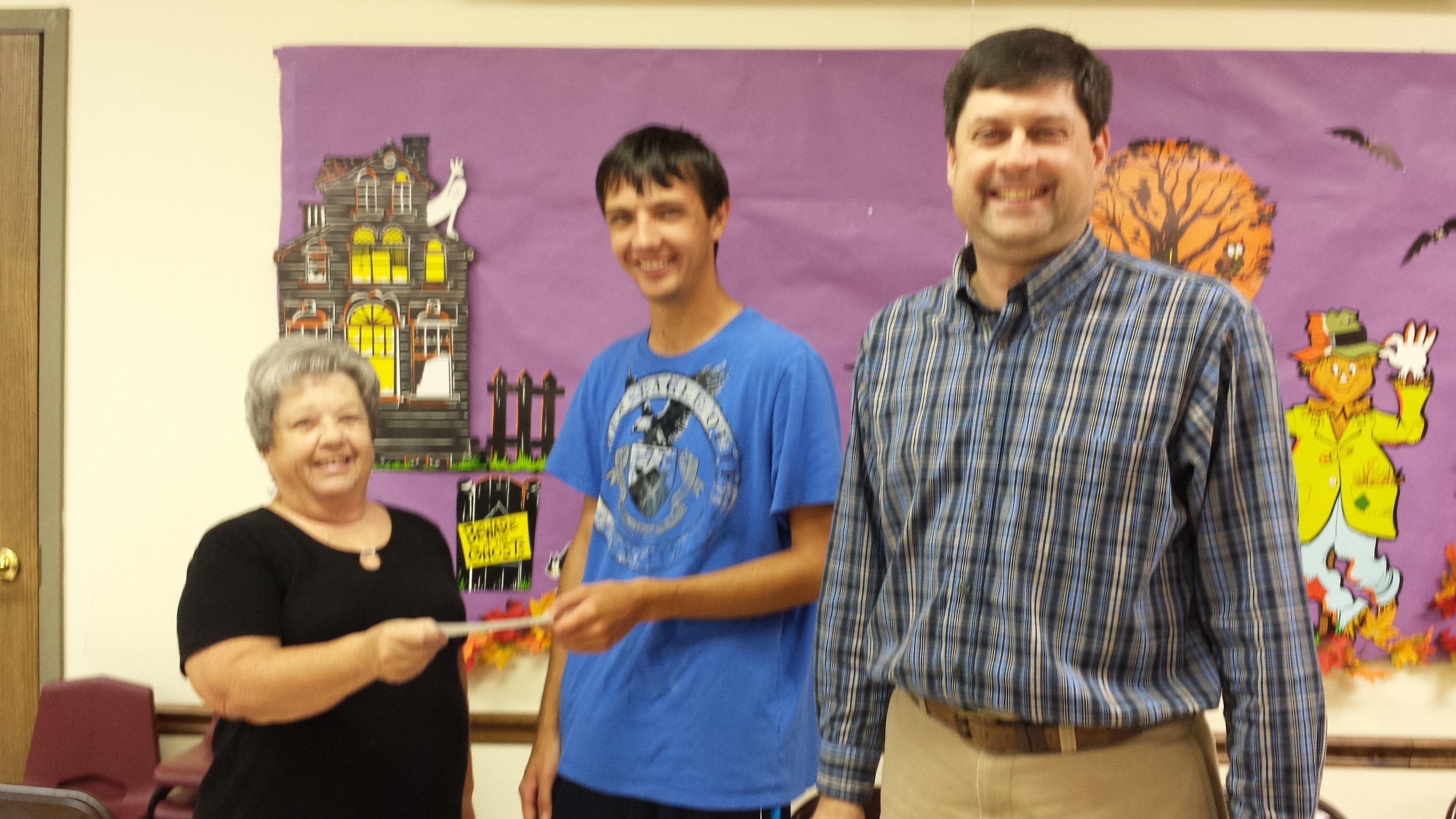 Taylor Briggs receives his scholarship money in 2013
