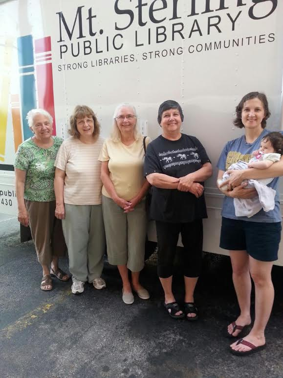 The May 2014 Book Club meeting included a tour of the library's Bookmobile was given to those who had not been aboard it before.