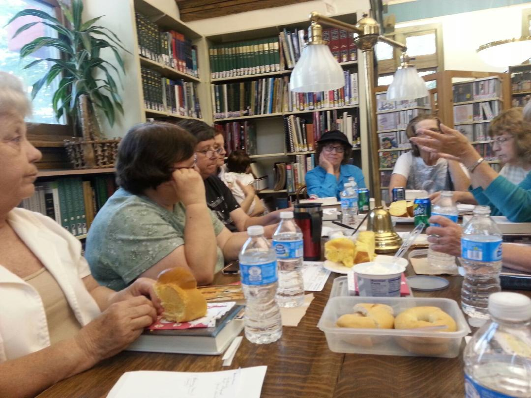 "TheMay 2014 ""Around Town"" Book Club took place in the library with 13 in attendance, including 2 new members and another that had joined in April."