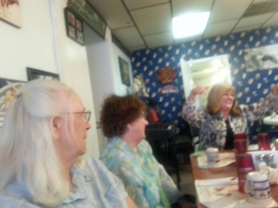Members Carolyn Tadlock and Casey O'Neill enjoy the joke by club host Melissa Reece