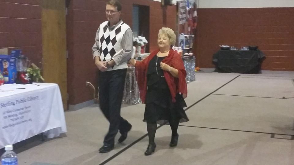 "FOL Treasurer Bev Bobo and her son-in-law Phillip walked the ""runway"" together"