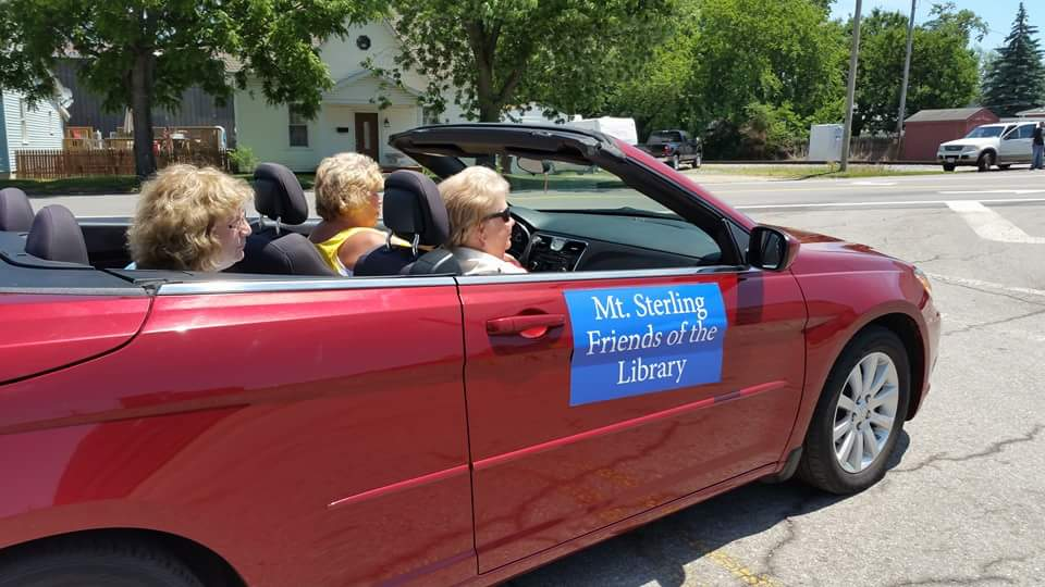 Some of the Friends of the Library members in the Mt. Sterling Community Days Parade are seen here as they pass out candy to the crowds