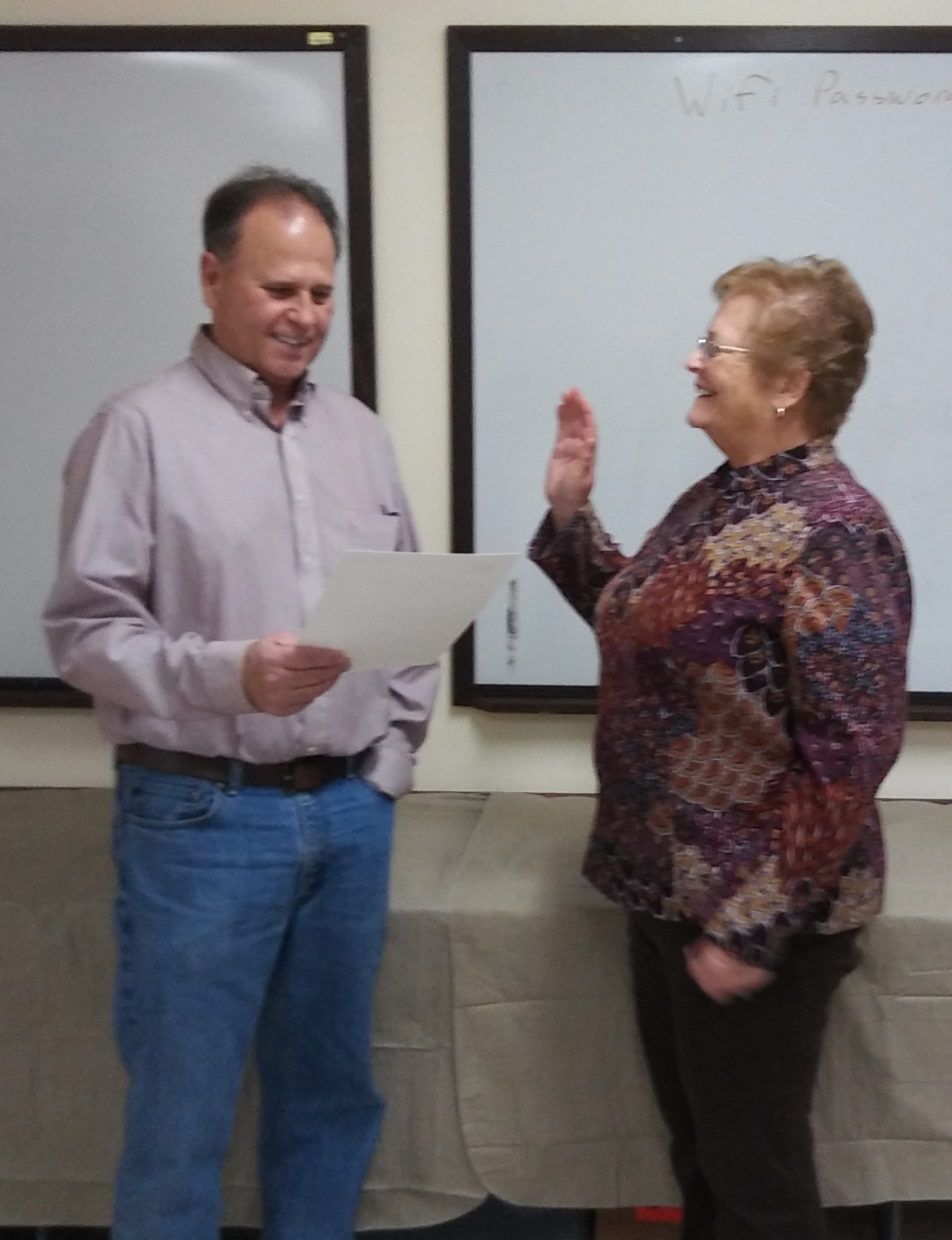 Pleasant Township trustee Sam Junk (left) recently admistered the swearing-in of Pat Baynes as Presiednt of the library and museum boards.