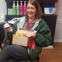 Bev Kern was a game prize winner at the February book club meeting held at Sharp Cuts Plus Salon
