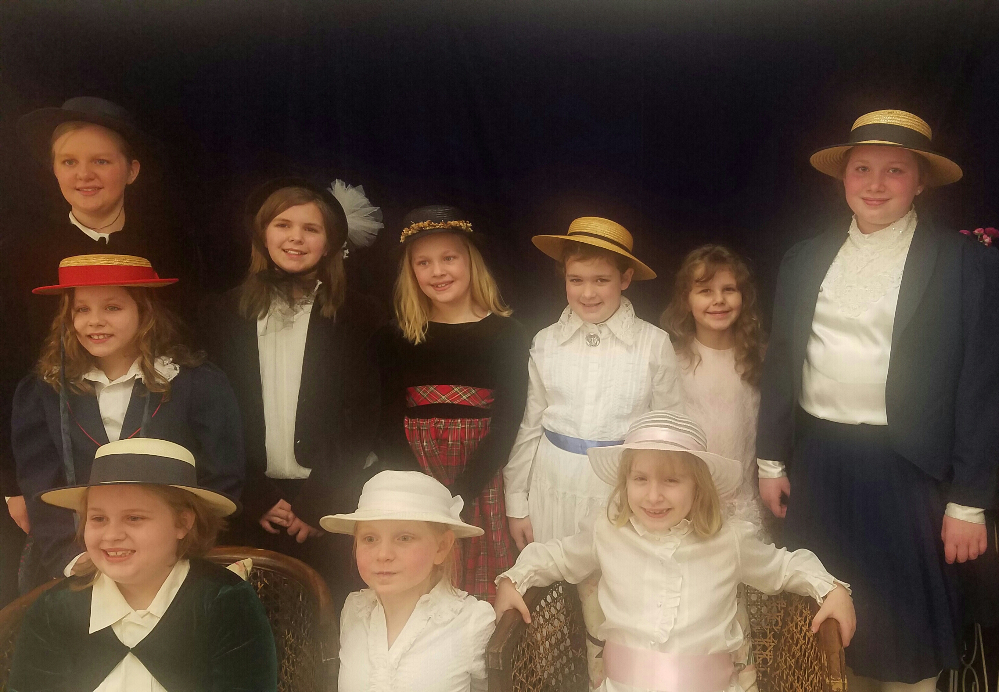 Members of local Girl Scout Troop 687 dressed in the spirit of the Victorian Sweetheart Tea.