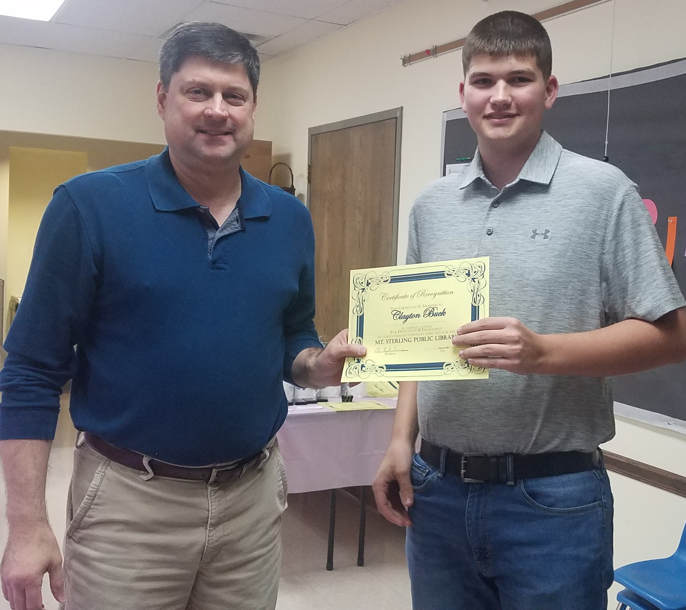 Clayton Buck received his recognition certificate as a volunteer library page.  Clayton volunteers monthly at the library, and is a Junior at Grove City Christian high school.