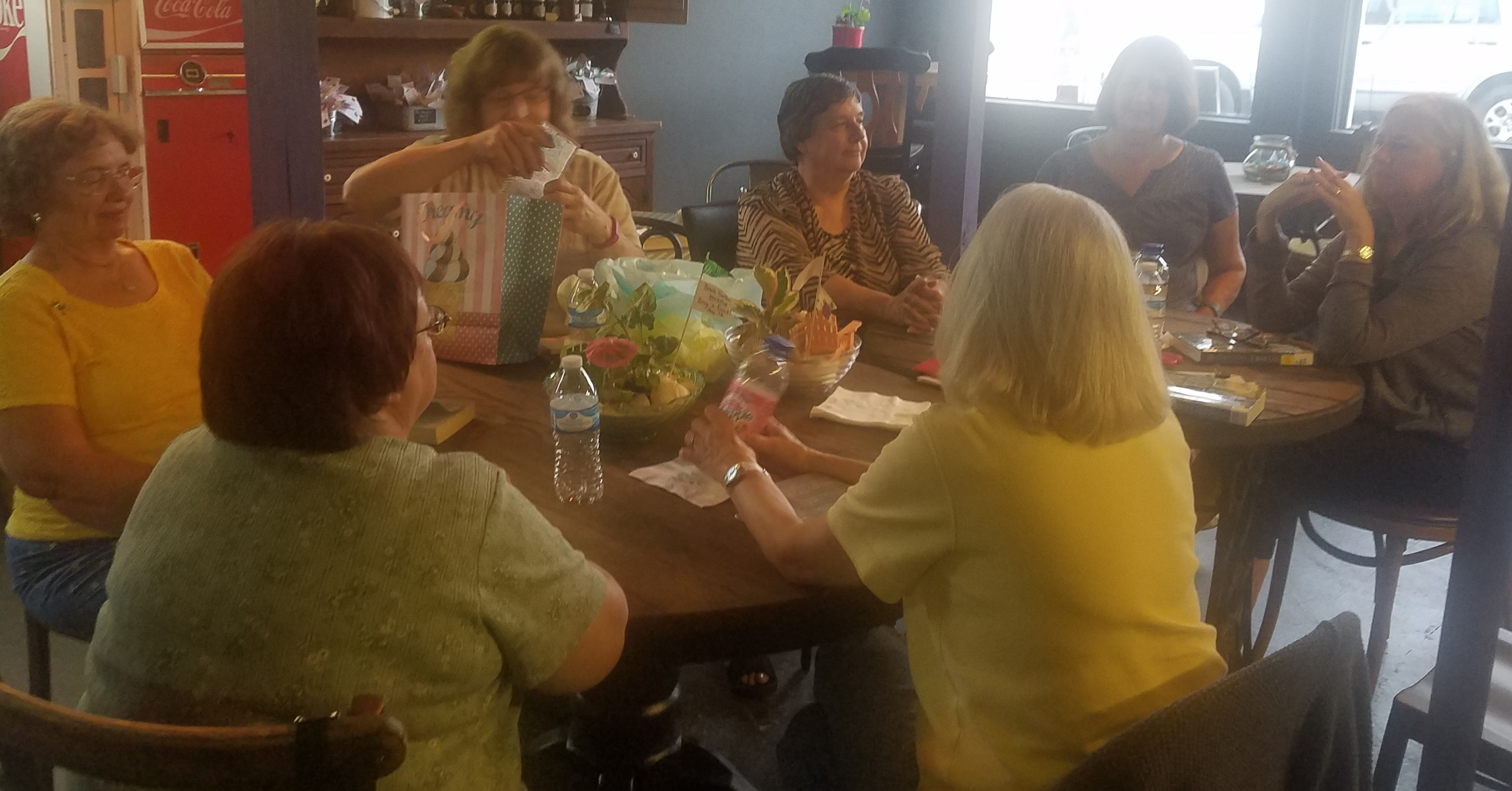 A great discussion and turnout was held at the Mad Hatter for the 'Around Town' Book Club's August meeting.