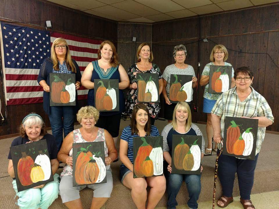 Some of the people who participated in our Friends of the Library's Annual Paint FUNdraiser are seen here with their versions of the finished products!