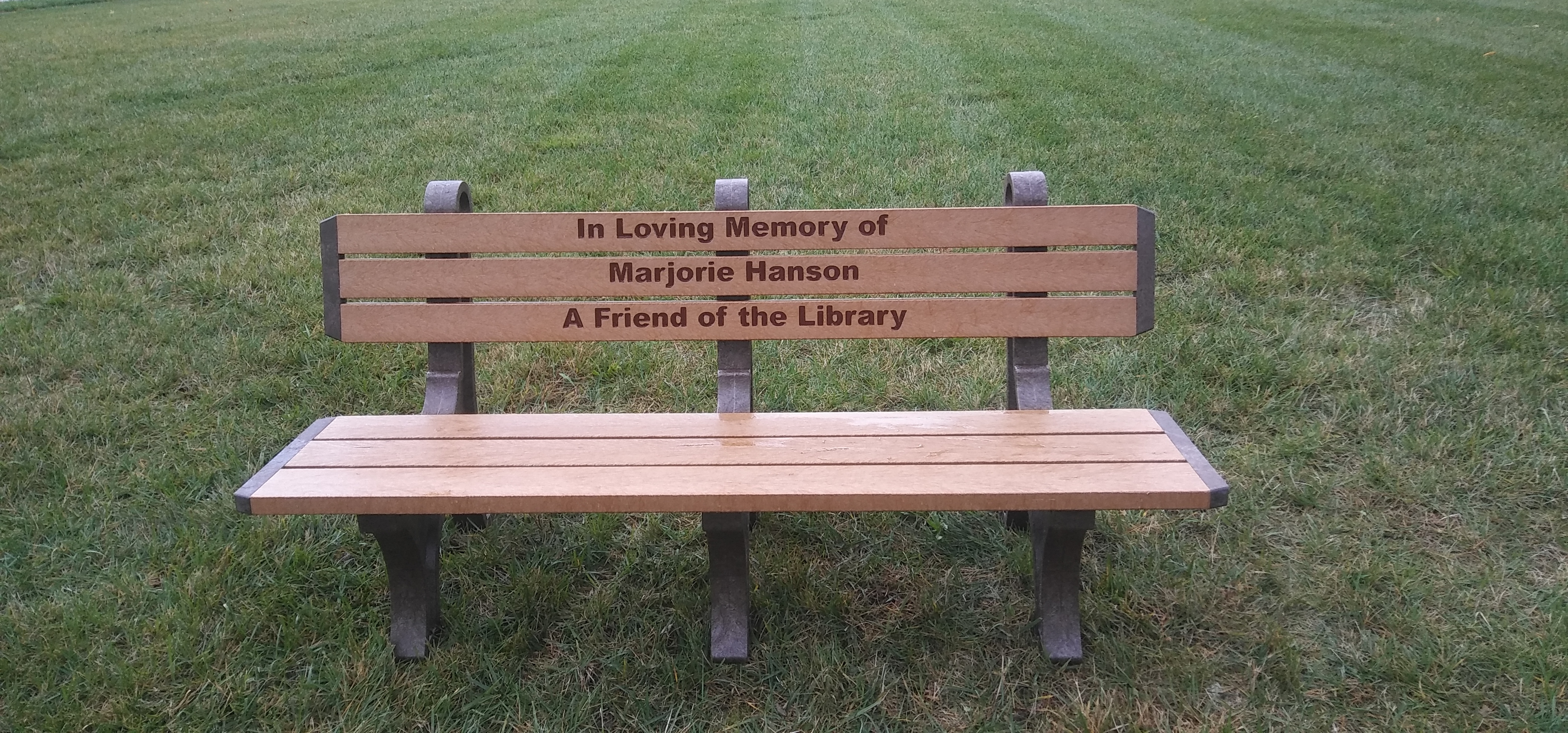 The Library has a new Memorial bench in place on our lawn, thanks to a donation from Stan Hanson. The bench is an additon to the first one the library received as a donation from the Friends of the Library two years ago.