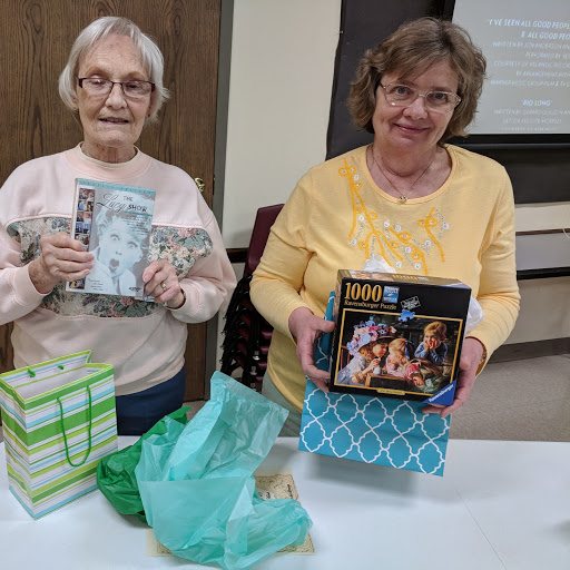 Shirley Riggleman and Sue Hallam were happy to be the lucky door prize winners at January's Ladies Night Out program.