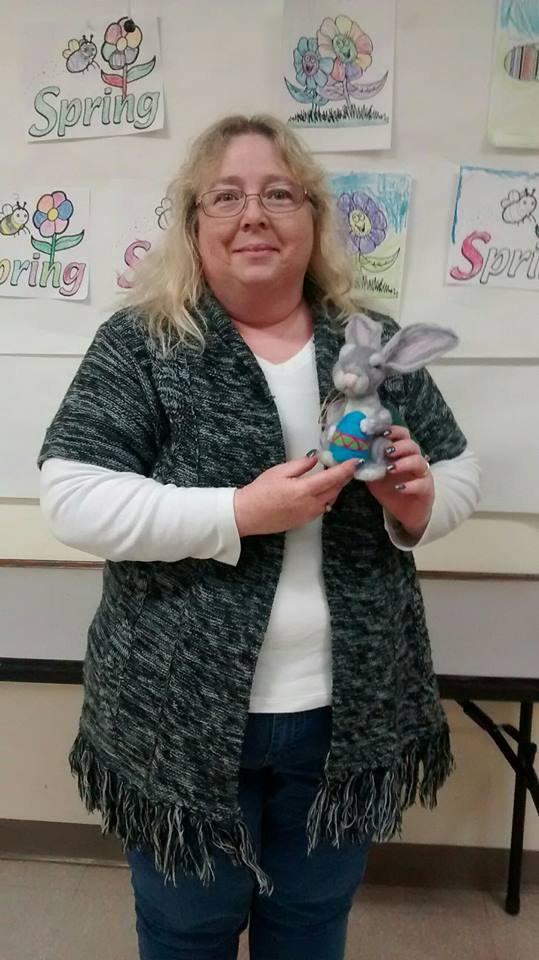 Lisa Meade is shown here as prize winner of the 'Around Town' Book Club in March, which is a handmade bunny and Easter egg made by Melissa Toppings.