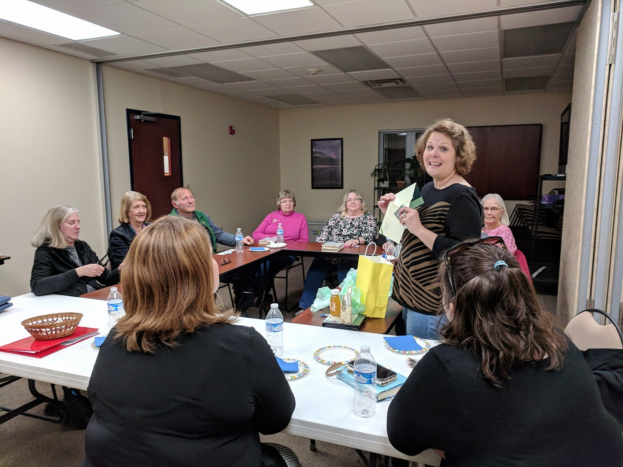 Carrie Alkire won the drawing at April's 'Around Town' Book Club meeting.  There were 12 members present for a fun discussion.