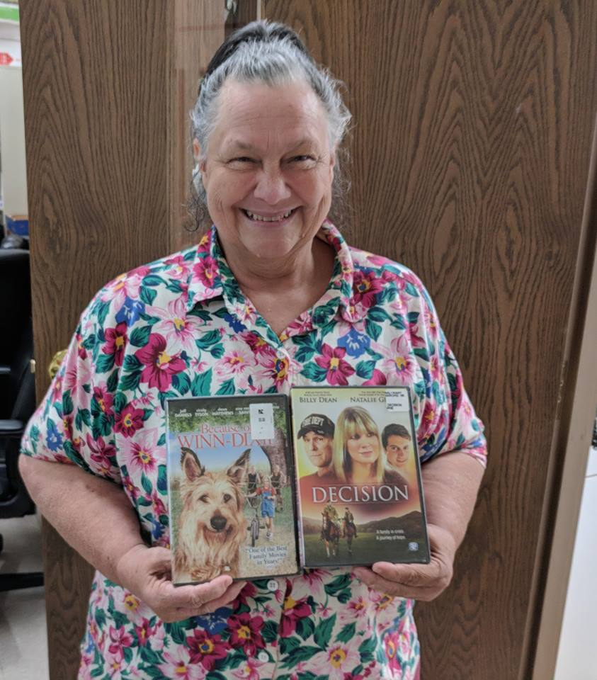 "Linda Wilson was the lucky winner of the 'guess the number game."" She chose two family films as her prizes."