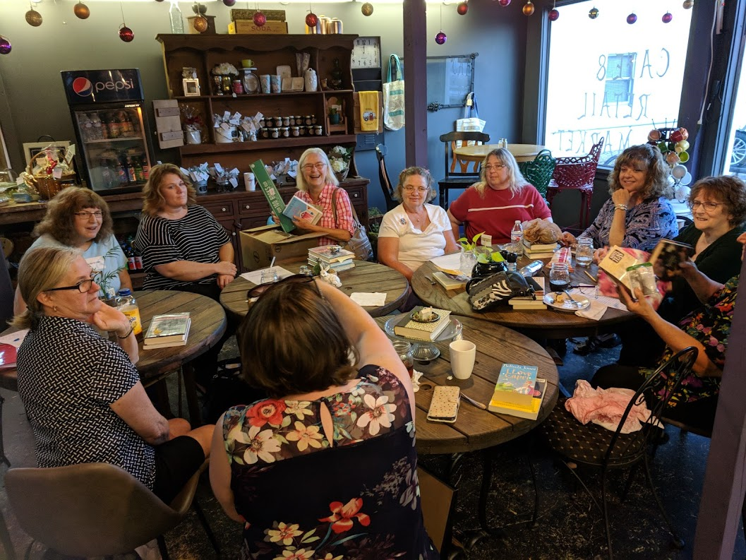 11 members from the 'Around Town' Book Club enjoyed yummy food and beverages at the Mad Hatter as they reviewed June's books.