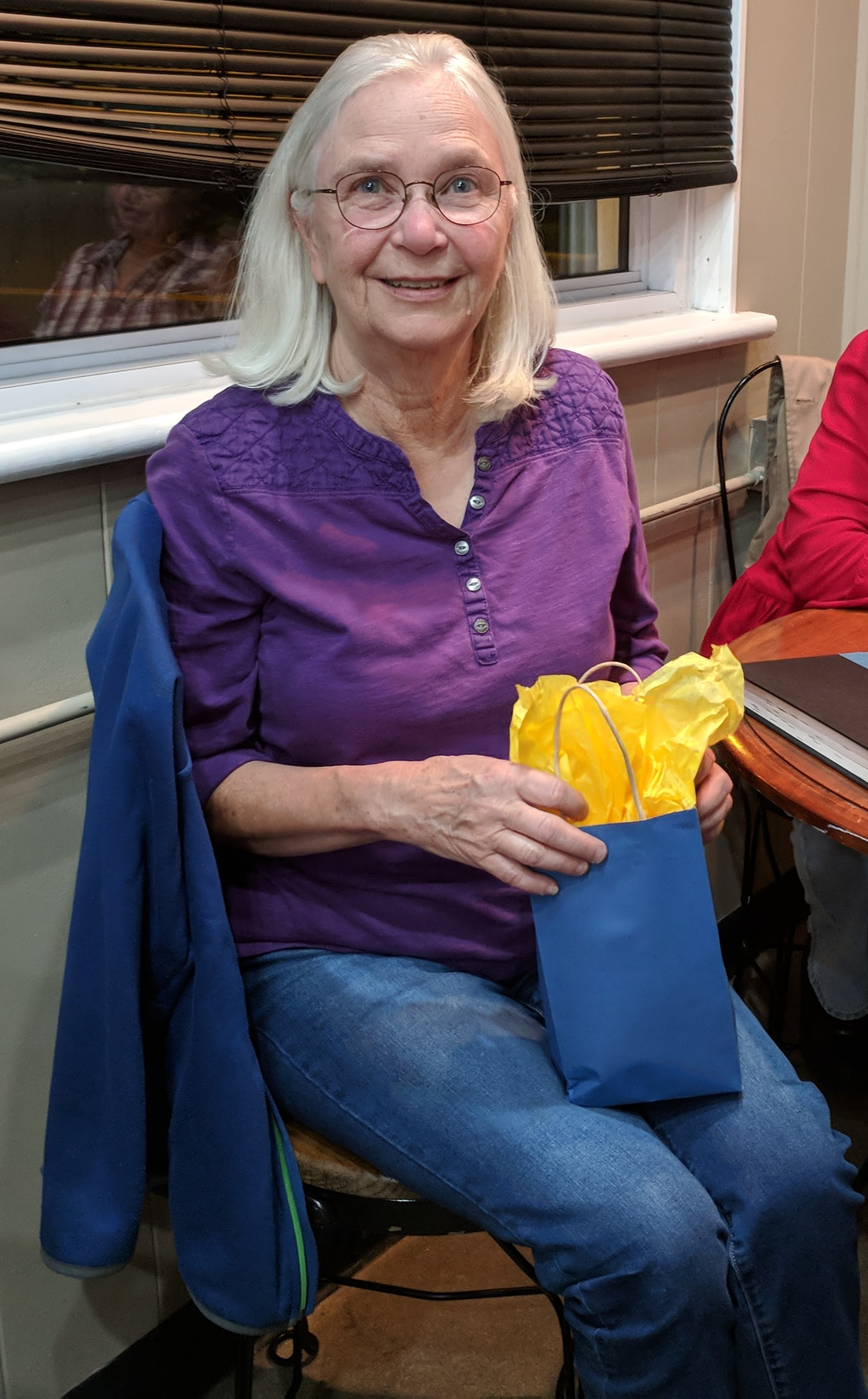 Congratulations to Carolyn Tadlock for winning the September book club prize. She won a honey's from Honey Run Farm, a back pack from the Friends of the Library, a first aid kit, and other items.