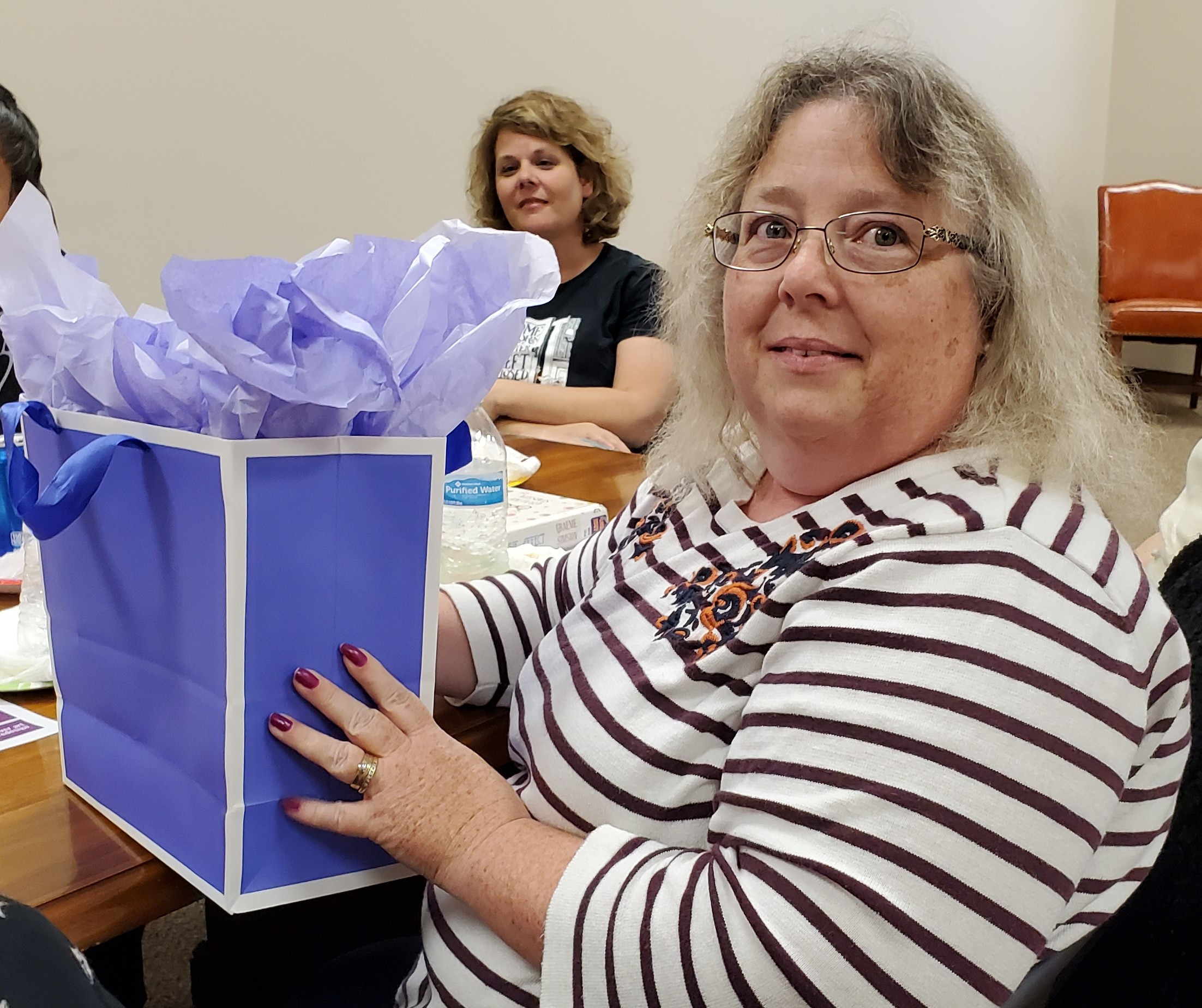 Lisa Meade was the lucky game prize winner at the June 'Around Town' Book Club meeting.