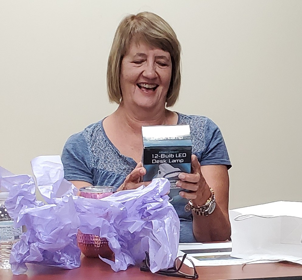 Congratulations to Bev Kern, as winner of the game prize at the July 'Around Town' Book Club meeting!
