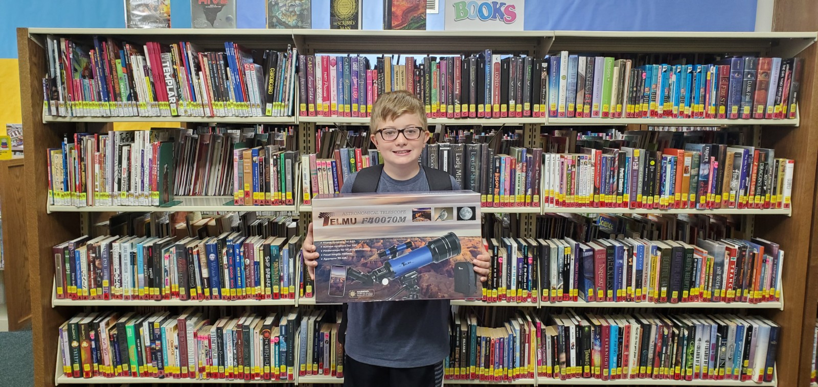 Congrats to lucky drawing winner Zavier Mayabb as winner of the children's grand prize for the Summer Reading Program. He won a fabulous new astronomical telescope!