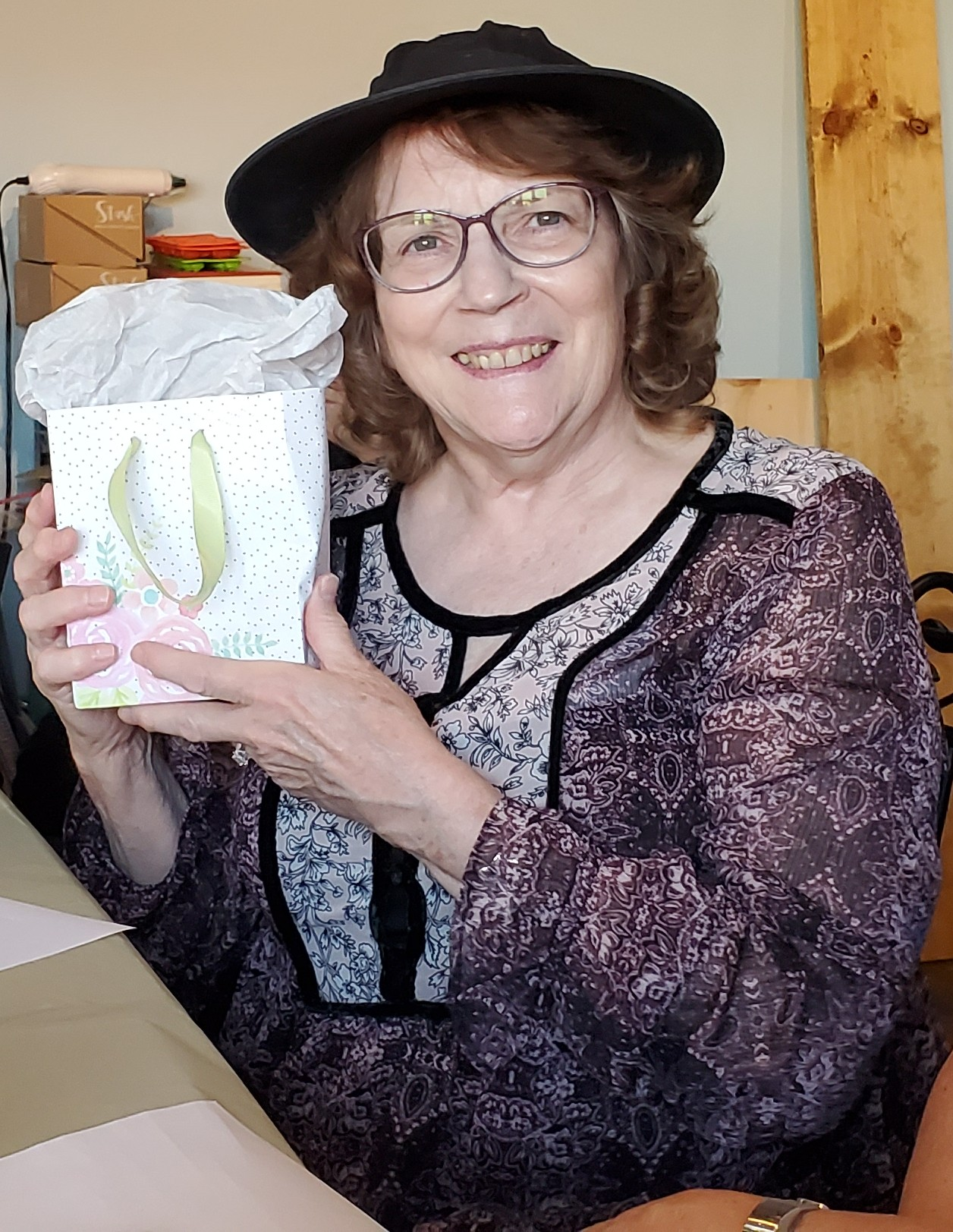 Casey O'Neill won some fun items by showing her memory of the book club story at the August 'Around Town' Book Club meeting.