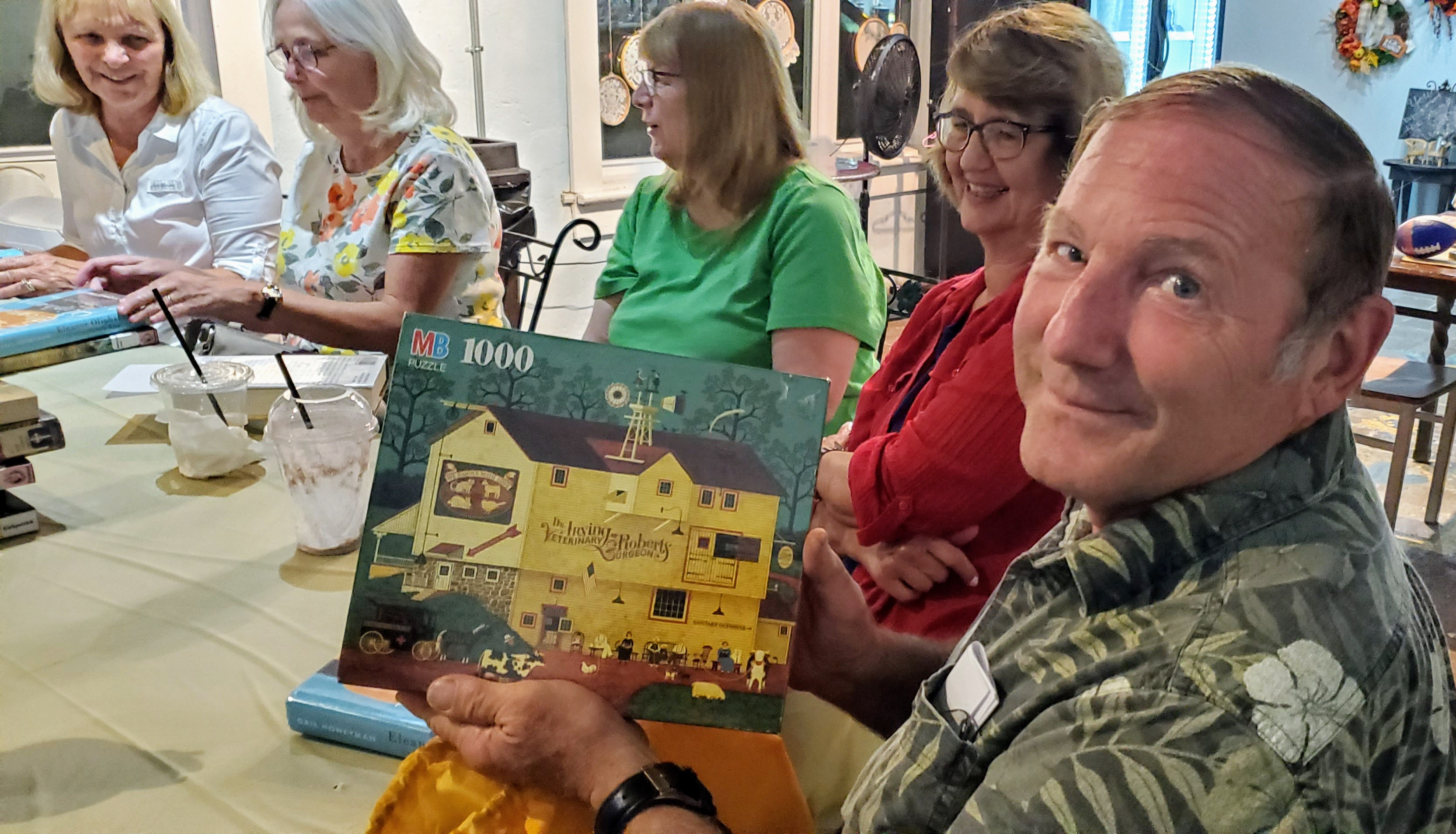 12 people attended the August 'Around Town' Book Club meeting held at Two Hands Coffee. Dr. Fred Brown was presented with a special door prize at the end of the meeting.