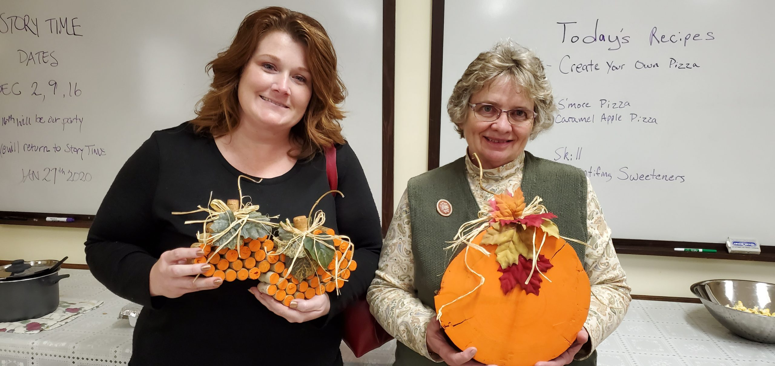 Christina Bennett (l) and Sue Hallam (r) were the lucky door prize winners at our November Ladies Night Out movie program. They won adorable hand crafted fall decor created by Assistant Librarian Judy Lucas.