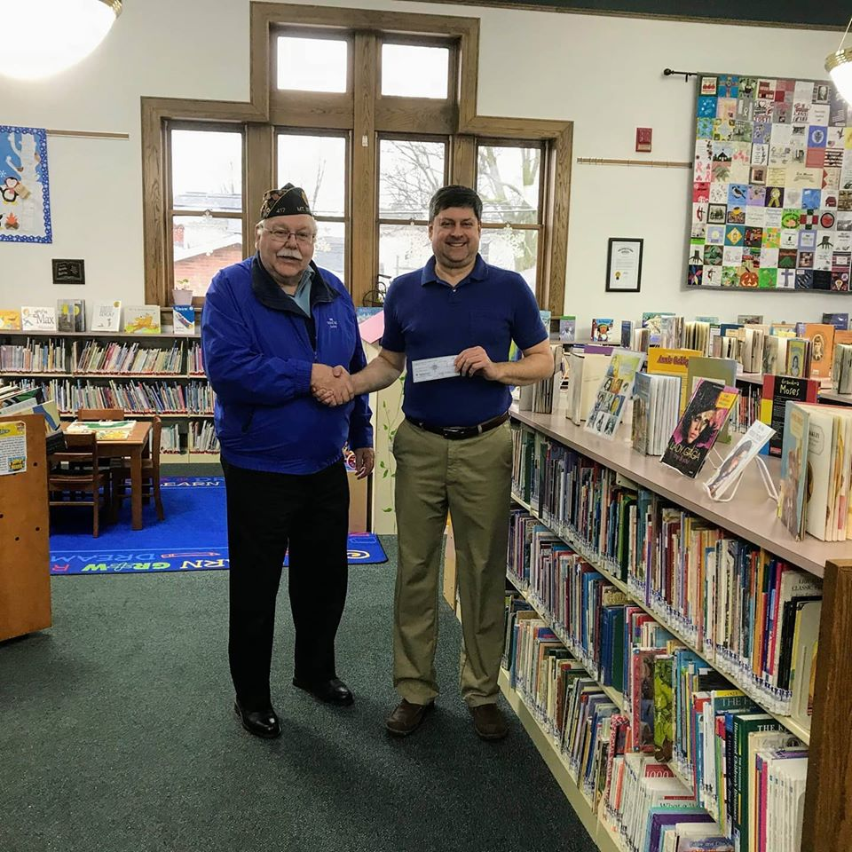 A huge thank you to American Legion Post 417 for their donation of $1,000 to sponsor the Summer Reading Program of 2020! Post Commander Wesley Pierce is seen here presenting the check to library director Chris Siscoe.