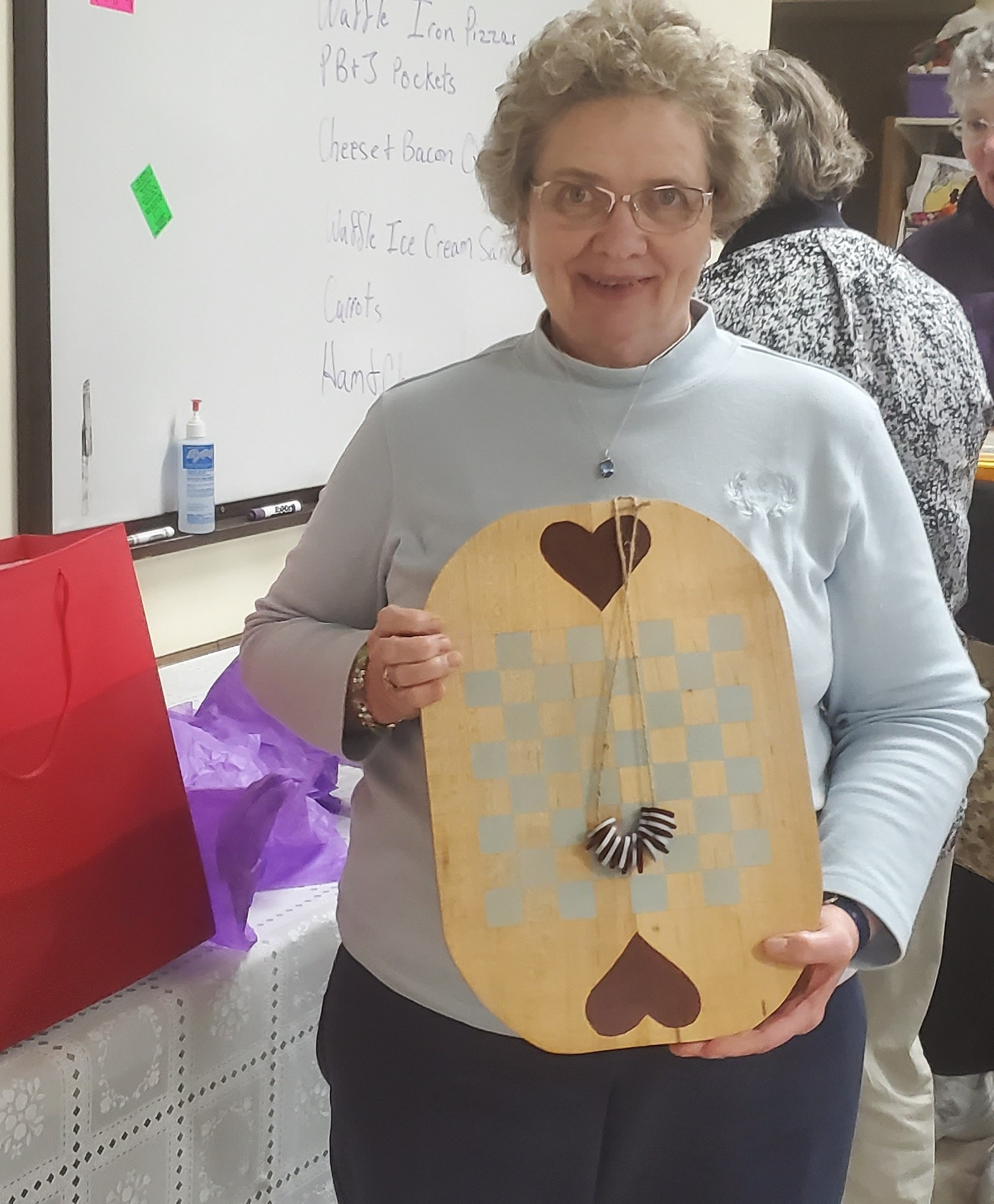 Congratulations to Sue Hallam as winner of our February Ladies Night Out prize drawing recipient. Sue won a solid wood folk art game set beautifully handcrafted by assistant librarian Judy.