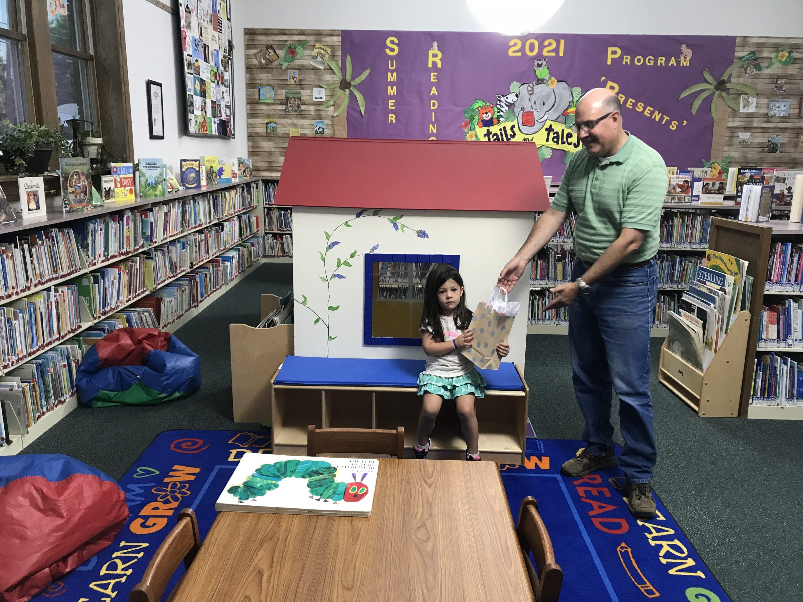 Norah Morris, age 3-12, was presented a Kid's Kindle & ear buds by library director Steve Brindza as a grand prize winner for her age group for our Summer Reading Program.